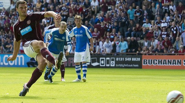 John Sutton scores Hearts first goal of the season. Right in front of the SimplyFixIt banner. Must be a good luck charm!