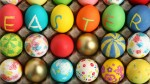 Some colourful eggs showing the message, Easter.