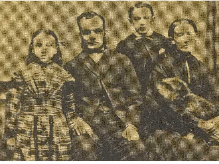 Photograph of Greyfriars Bobby. The late Mr Traill and family, with Greyfriars Bobby in Mrs Traill's lap