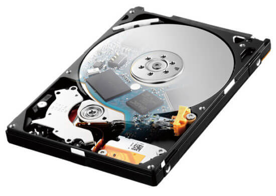 photo of a computer's hard drive. the top cover has been removed so that you can see the drive platters inside