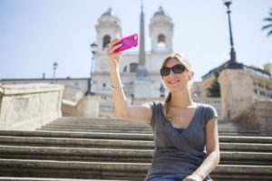 Woman on some steps taking a selfie
